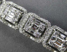 ESTATE WIDE 6.64CT ROUND & BAGUETTE DIAMOND 18KT WHITE GOLD HALO TENNIS BRACELET