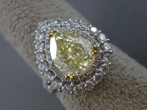 LARGE GIA 4.25CT WHITE & FANCY YELLOW DIAMOND 18KT TWO TONE GOLD ENGAGEMENT RING