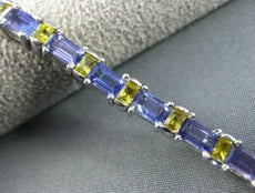 ESTATE WIDE 7.04CT TANZANITE & YELLOW SAPPHIRE 18KT WHITE GOLD TENNIS BRACELET
