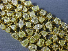 LARGE 34.44CT FANCY YELLOW DIAMOND 18KT YELLOW GOLD 3D CLUSTER TENNIS BRACELET