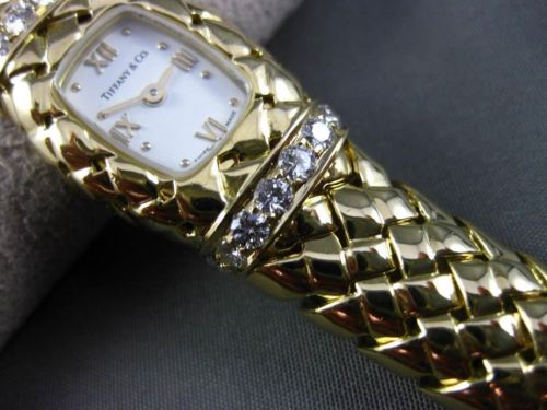 LARGE TIFFANY & CO 1.12CT DIAMOND 18KT YELLOW GOLD WOVEN SWISS LADIES WATCH 2990