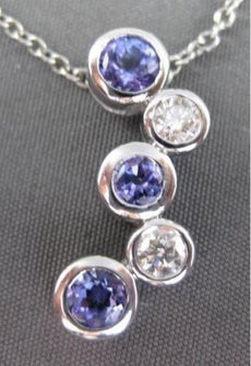 ESTATE .85CT AAA TANZANITE & DIAMOND 14KT WHITE GOLD FLOATING JOURNEY PENDANT