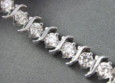 ESTATE WIDE & LONG 5.00CT DIAMOND 14KT WHITE GOLD S SHAPE TENNIS BRACELET