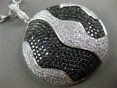 LARGE 4.51CT WHITE & BLACK DIAMOND 18KT WHITE & BLACK GOLD CIRCULAR WAVE PENDANT