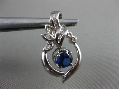 ANTIQUE .62CT DIAMOND & SAPPHIRE 18KT WHITE GOLD SOLITAIRE LEAF FLOATING PENDANT
