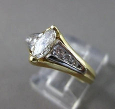 ESTATE .85CT DIAMOND 14KT 2 TONE GOLD MARQUISE TENSION SET ENGAGEMENT RING 16335