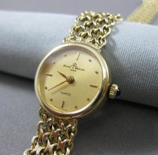 ESTATE 14KT YELLOW GOLD BAUME & MERCIER GENEVE QUARTZ SWISS ROUND WATCH #14846