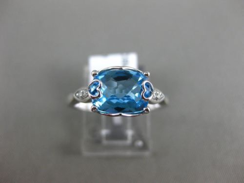 2.16CT DIAMOND & AAA BLUE TOPAZ 14KT WHITE GOLD DOUBLE HEART FILIGREE LOVE RING