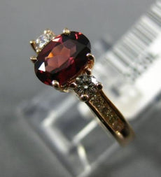 1.40CT ROUND DIAMOND & OVAL RHODOLITE 14KT ROSE GOLD THREE STONE ENGAGEMENT RING