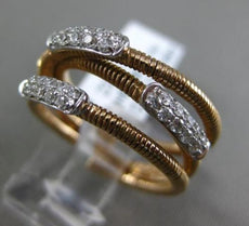 ESTATE .27CT DIAMOND 18KT WHITE & ROSE GOLD 3D 3 ROW CRISS CROSS FLEXIBLE RING
