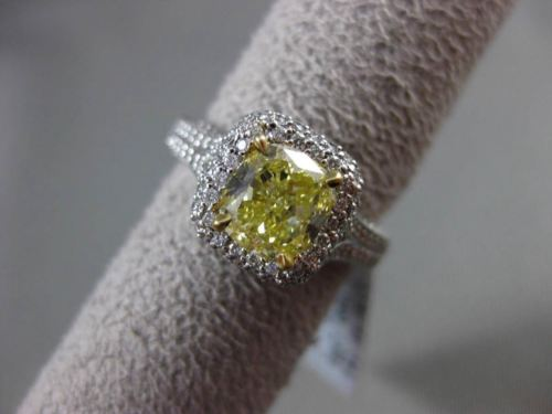 ESTATE 2.26CTW GIA FANCY YELLOW DIAMOND 18KT WHITE GOLD HALO ENGAGEMENT RING