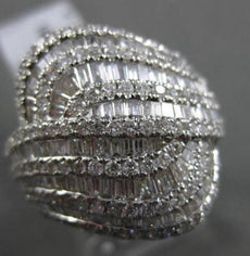 ESTATE 2.15CT BAGUETTE & ROUND DIAMOND 18KT WHITE GOLD INTERTWINNING FUN RING