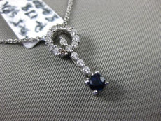 ESTATE .48CT DIAMOND & SAPPHIRE 18KT WHITE GOLD CIRCLE OF LIFE FLOATING PENDANT