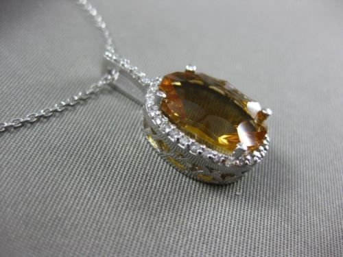 ESTATE LARGE 5.77CT DIAMOND & CITRINE 14KT WHITE GOLD OVAL HALO FLOATING PENDANT