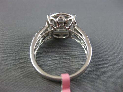 LARGE .85CT ROUND & BAGUETTE DIAMOND 18KT WHITE GOLD 3D CLUSTER ENGAGEMENT RING