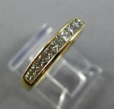 ESTATE .27CT DIAMOND 14KT YELLOW GOLD 9 STONE PRINCESS CHANNEL ANNIVERSARY RING