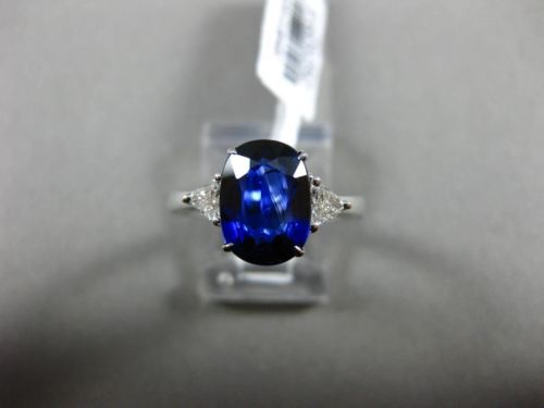 3.07CT TRILLION DIAMOND & OVAL SAPPHIRE 18KT WHITE GOLD 3 STONE ENGAGEMENT RING