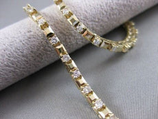 "ANTIQUE 1.00CTW DIAMOND 14KT YELLOW GOLD RAISED LINE TENNIS BRACELET 7.5"" #20438"