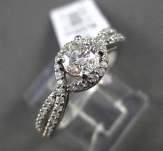 ESTATE .79CT ROUND DIAMOND 14KT WHITE GOLD SOLITARE INFINITY ENGAGEMENT RING