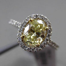 ESTATE 1.32CT GIA FANCY YELLOW DIAMOND 18KT WHITE GOLD OVAL HALO ENGAGEMENT RING