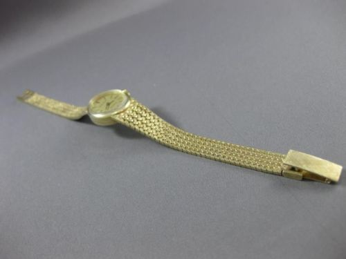 ESTATE 14KT YELLOW GOLD SIMPLE OVAL QUARTZ SWISS MOVEMENT PALACE WATCH #19035