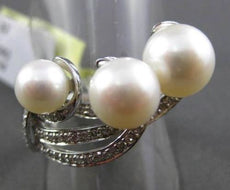 ESTATE WIDE .32CT DIAMOND & AAA NATURAL SOUTH SEA PEARL 18KT WHITE GOLD FUN RING