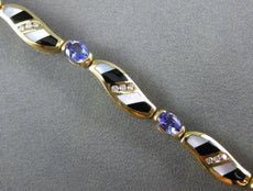 ESTATE 1.87CT DIAMOND & AAA TANZANITE & MULTI GEM 14KT YELLOW GOLD WAVE BRACELET