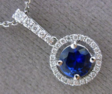 ESTATE .80CT DIAMOND & SAPPHIRE 18KT WHITE GOLD CLASSIC ROUND FLOATING PENDANT