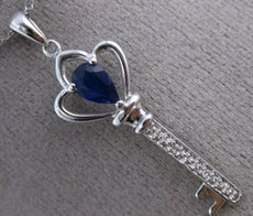ESTATE .45CT DIAMOND & SAPPHIRE 14KT WHITE GOLD KEY TO MY HEART FLOATING PENDANT