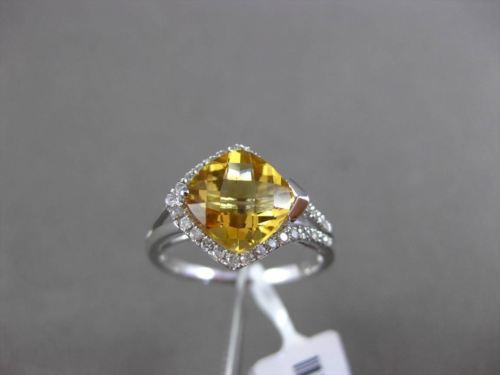 ESTATE 2.25CT TWISTED DIAMOND & CITRINE 14KT WHITE GOLD FLOATING ENGAGEMENT RING