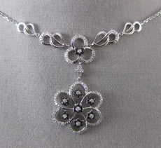 ESTATE .59CT WHITE & BLACK DIAMOND 14KT WHITE GOLD 3D FLOATING FLOWER NECKLACE
