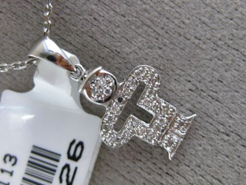 ESTATE SMALL .18CT DIAMOND 14KT WHITE GOLD 3D HAPPY BABY BOY FLOATING PENDANT