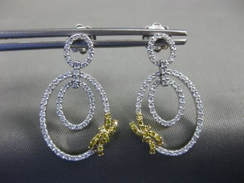 .85CT WHITE & FANCY YELLOW DIAMOND 18KT TWO TONE GOLD OVAL BOW HANGING EARRINGS