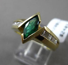 ESTATE 1.10CTW DIAMOND & AAA MARQUISE EMERALD 14KT YELLOW GOLD ENGAGEMENT RING
