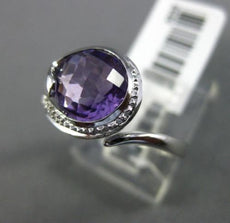ESTATE 2.05CT DIAMOND & AAA EXTRA FACET AMETHYST 14KT WHITE GOLD SWIRL LOVE RING