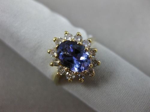 1.83CT DIAMOND & AAA OVAL TANZANITE 14KT YELLOW GOLD FLOWER HALO ENGAGEMENT RING