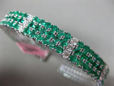 ESTATE WIDE 14.02CT DIAMOND & AAA EMERALD 18KT WHITE GOLD 3 ROW BANGLE BRACELET