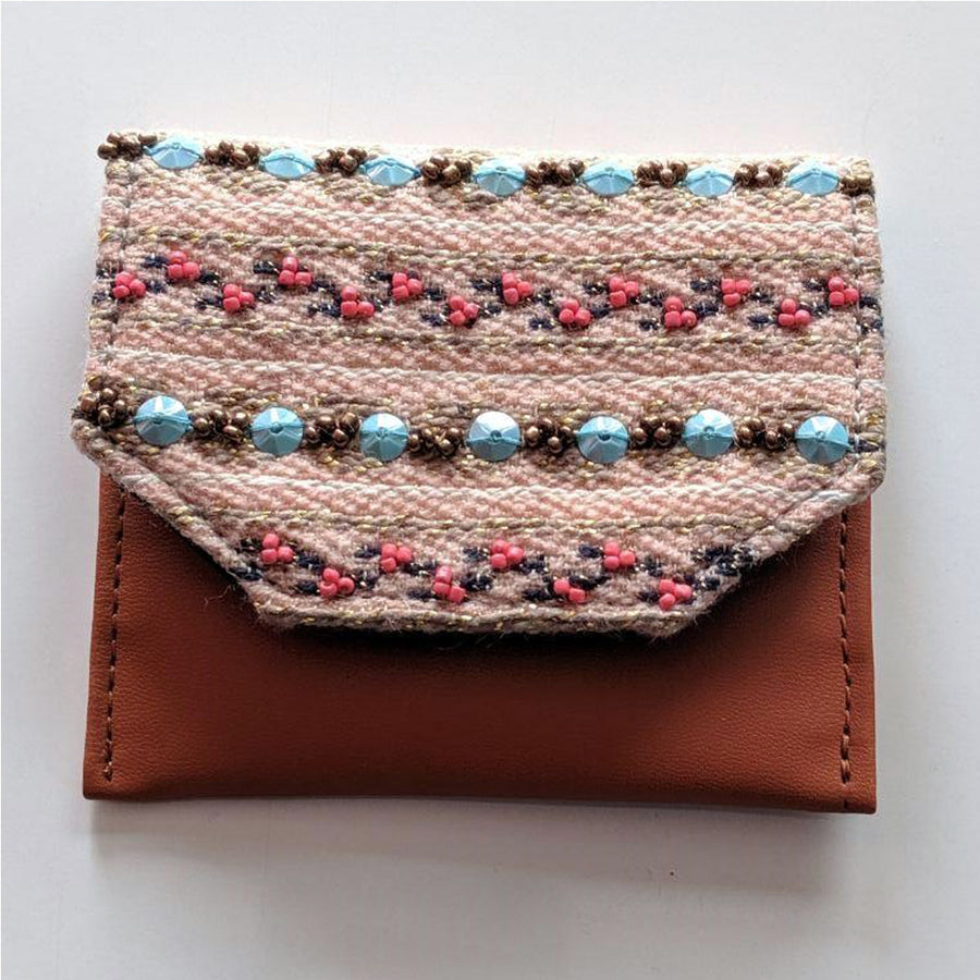 Bling up your daily shopping spree with this quirky hand embroidered wallet which also happens to be a perfect gift for your favourite shopping partner!