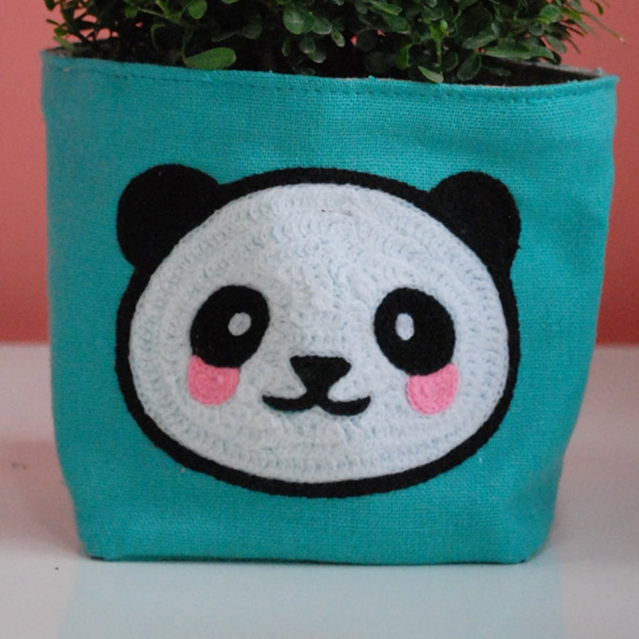 SOOTHING PLANT AND A PLANT COVER WITH PANDA EMBROIDERY