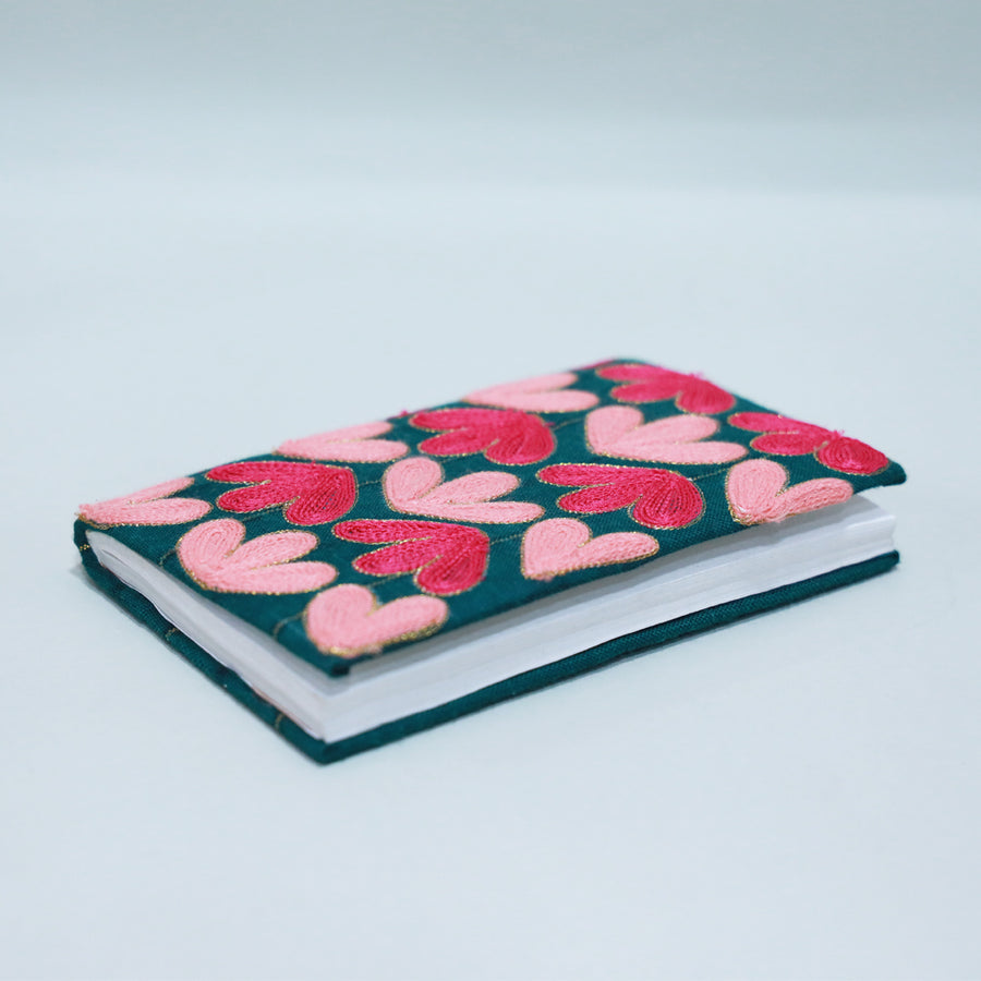 Pen down your daily thoughts on this beautiful hand embroidered diary which comes with a reusable cover.