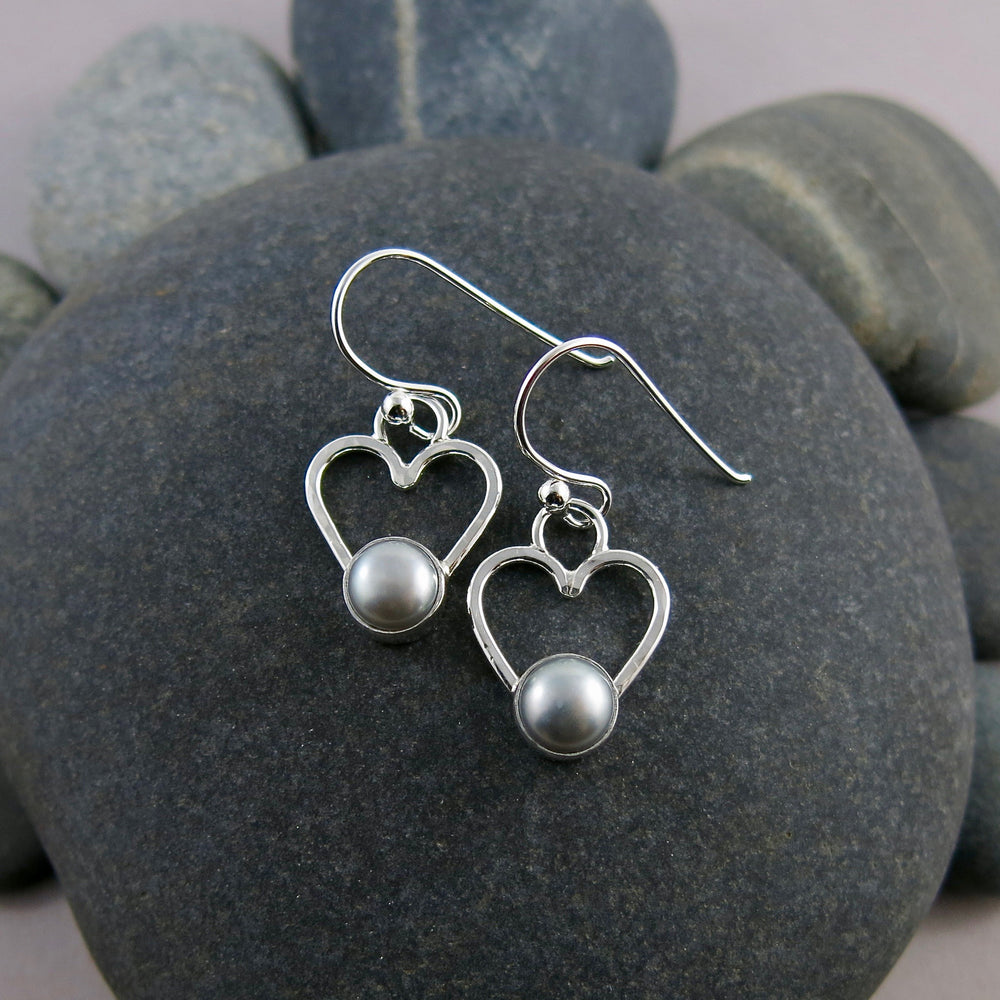 Pearl heart earrings by Mikel Grant Jewellery. Grey freshwater pearls on sterling silver open hearts.