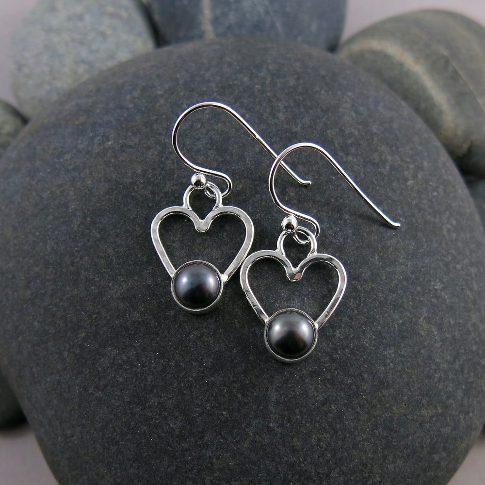 Pearl heart earrings by Mikel Grant Jewellery.  Black freshwater pearls on sterling silver open hearts.