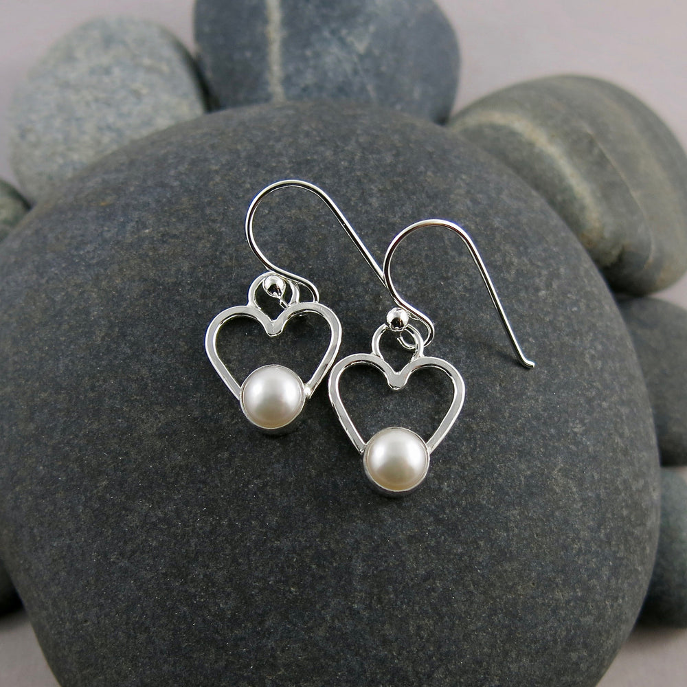 Pearl heart earrings by Mikel Grant Jewellery. White freshwater pearls on sterling silver open hearts.