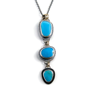 Artisan made Cascade Necklace. Kingman turquoise in oxidized textured sterling silver with 14K gold accents by Mikel Grant Jewellery.