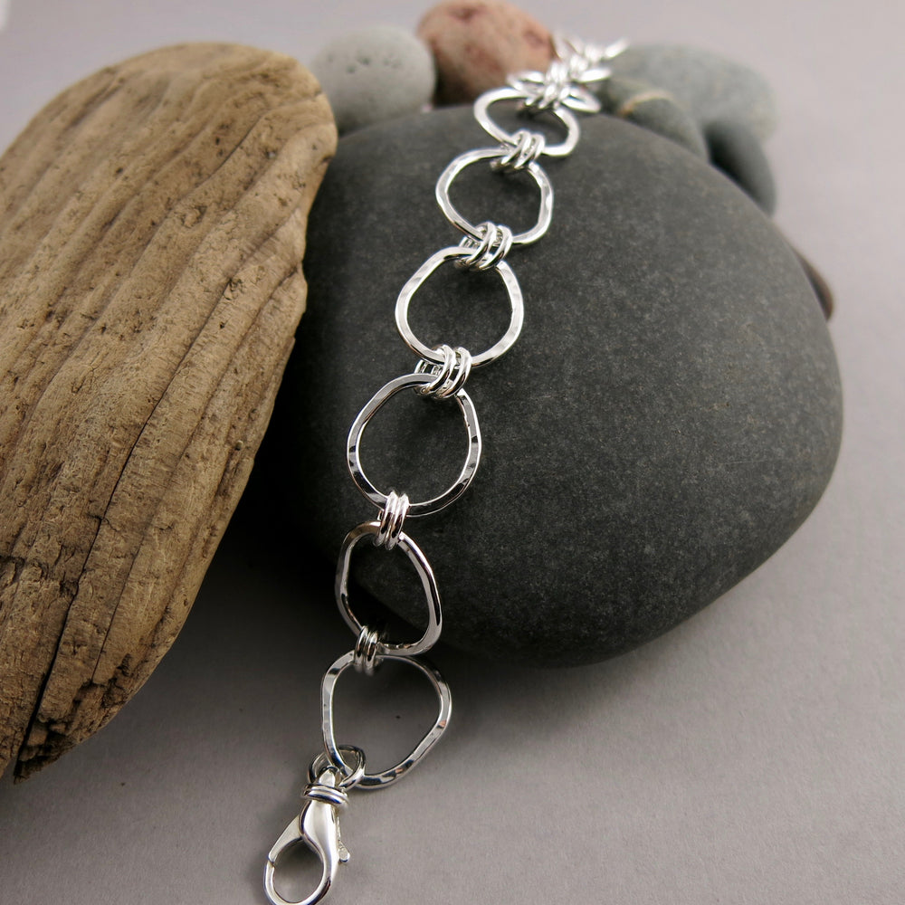 Coast Bracelet: beach inspired, artisan made.  Free form silver adjustable link bracelet with rustic hammer texture by Mikel Grant Jewellery