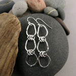 Coast Trio Drop Earrings: hammer textured free form sterling silver long statement earrings by Mikel Grant Jewellery