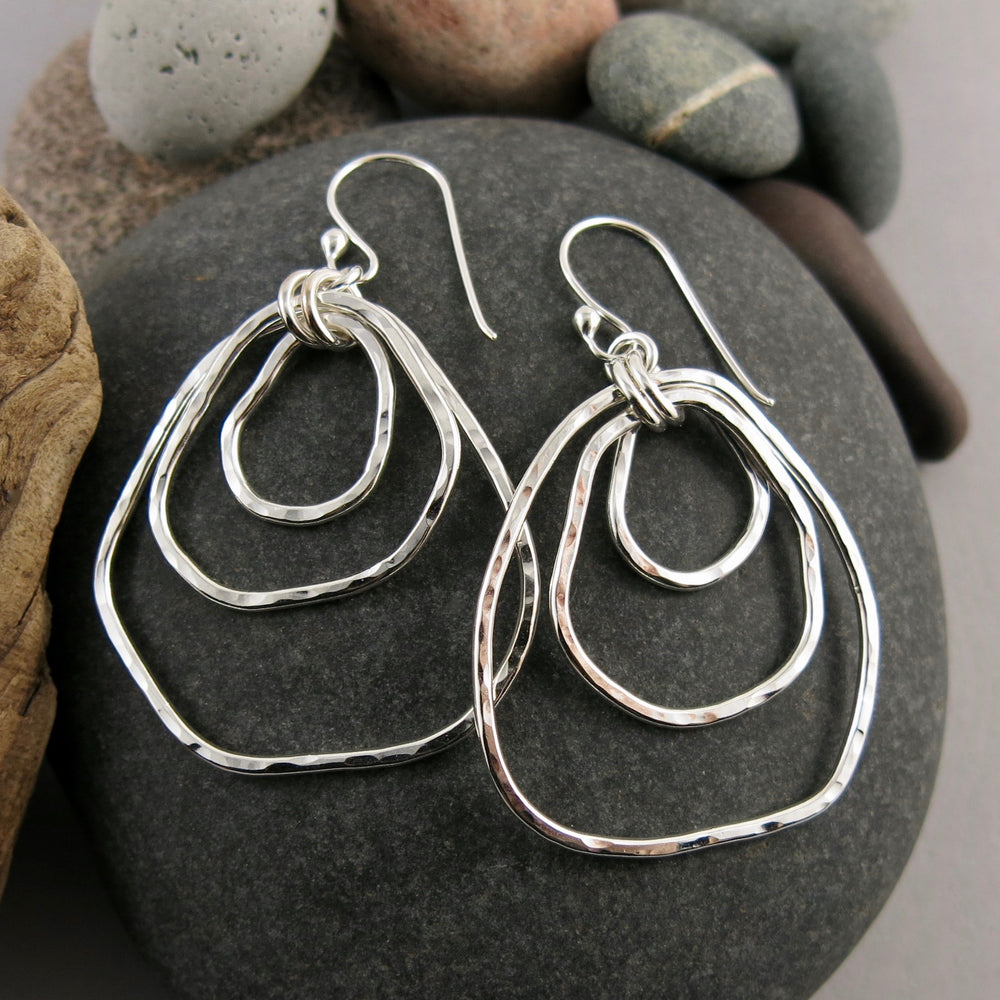 Coast Trio Earrings: free form nesting silver dangles with rustic hammer texture by Mikel Grant Jewellery