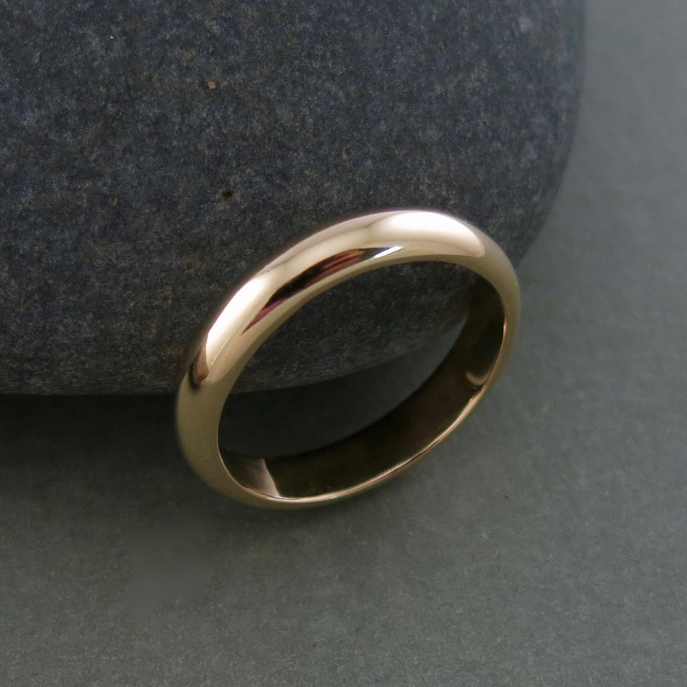 Bespoke wedding ring in 14K yellow gold by Mikel Grant Jewellery.  Simple, classic, enduring.