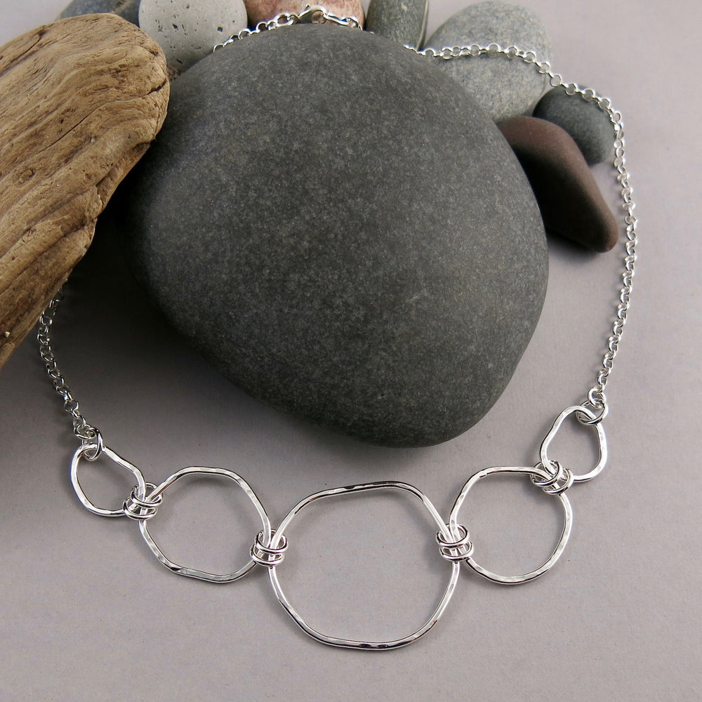 Coast Graduated Necklace: west coast beach inspired focal statement necklace. Free form sterling silver graduated links with rustic hammer texture by Mikel Grant Jewellery