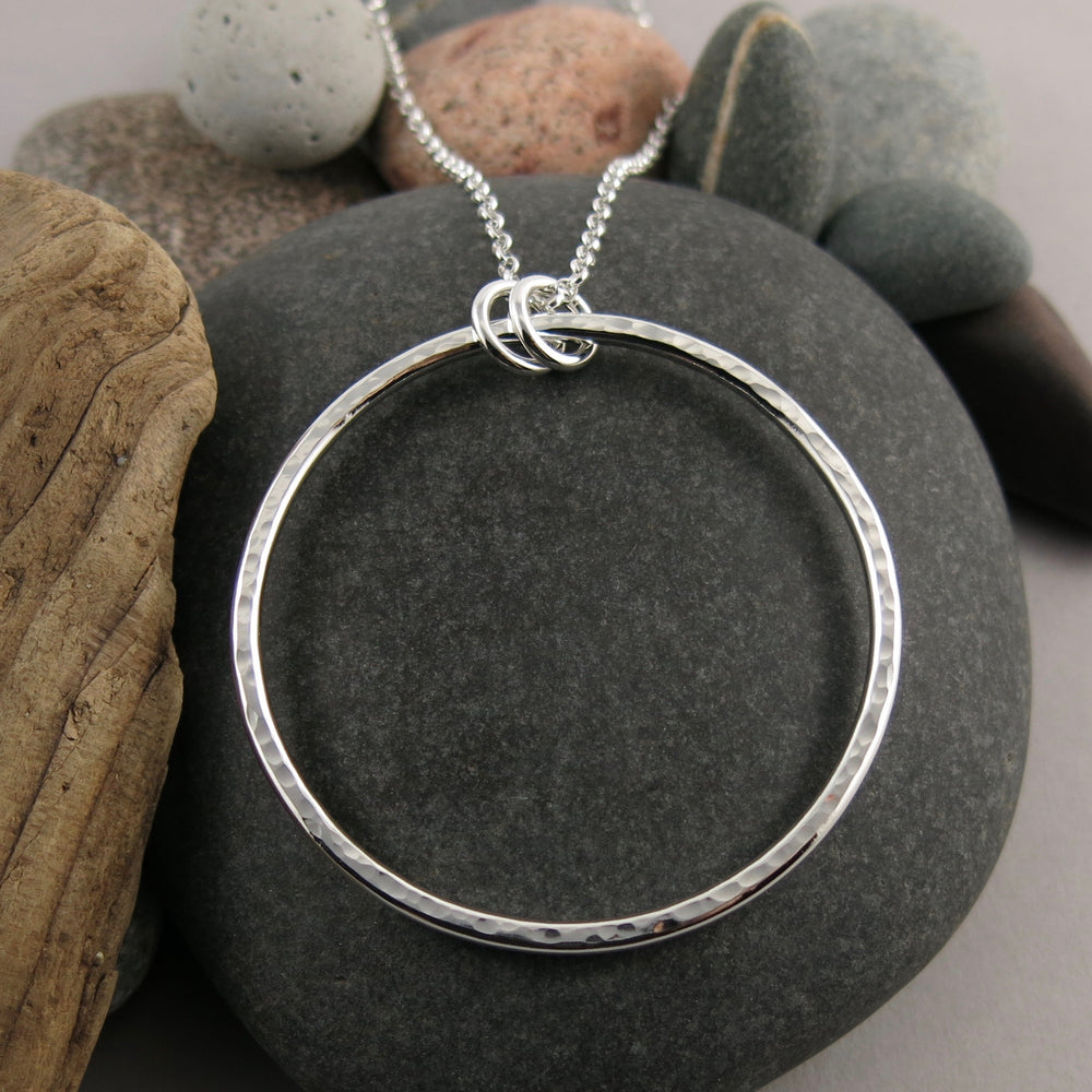"Artisan made open circle necklace in thick, hammer textured sterling silver with a long 30"" silver rolo chain by Mikel Grant Jewellery."